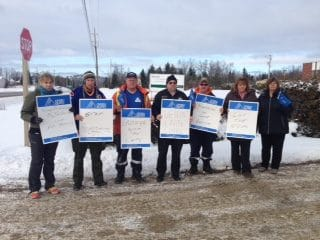 OPSEU members hold up signs as they attend rally in Terrace Bay