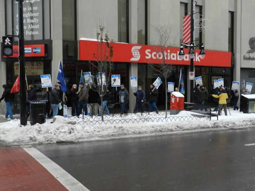 OPSEU members holding signs during rally in Kingston