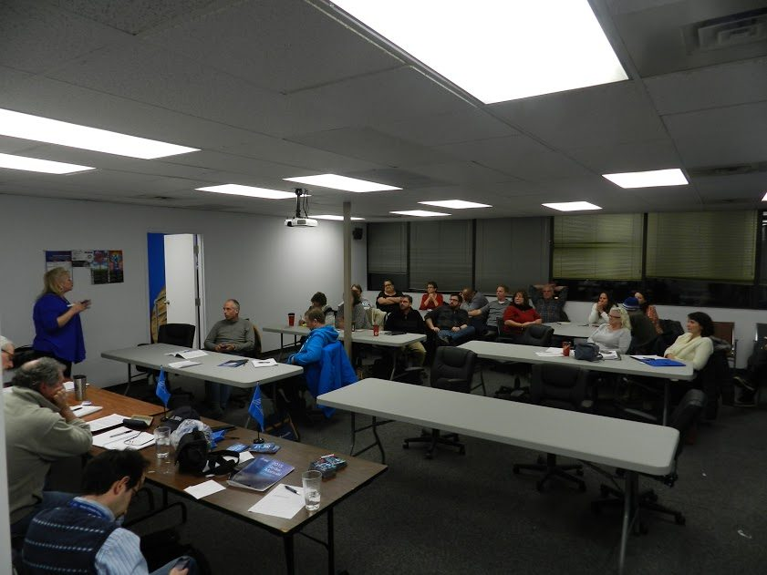 OPSEU members sitting around tables at meeting in Ottawa