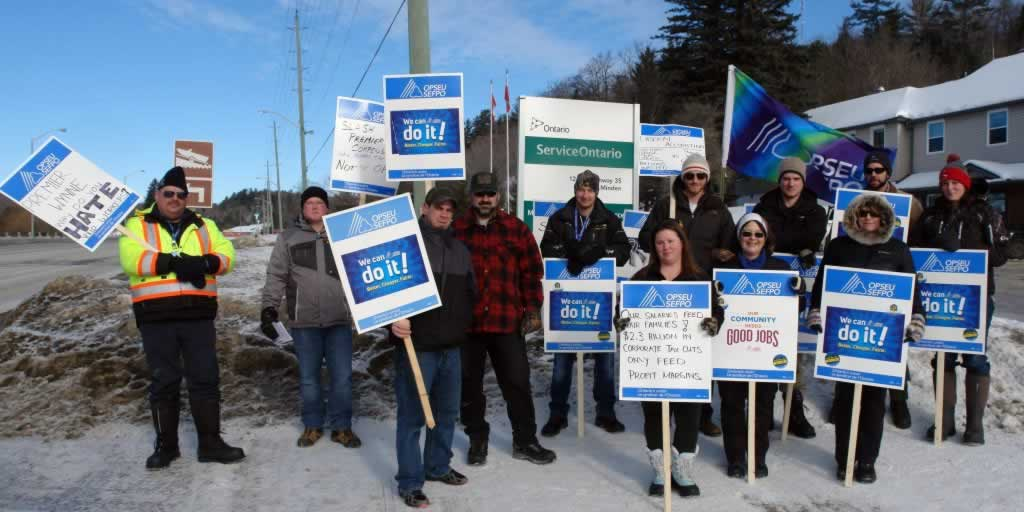 OPSEU members holding signs and flags in Minden