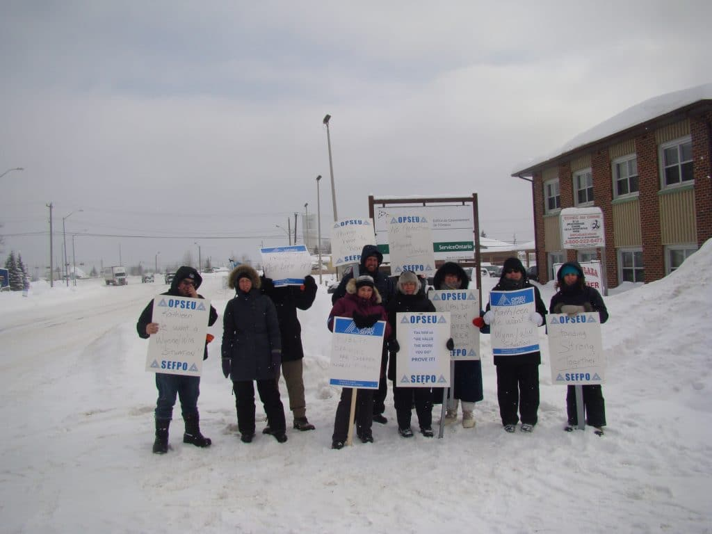 OPSEU members on strike, holding picket signs in Hearst