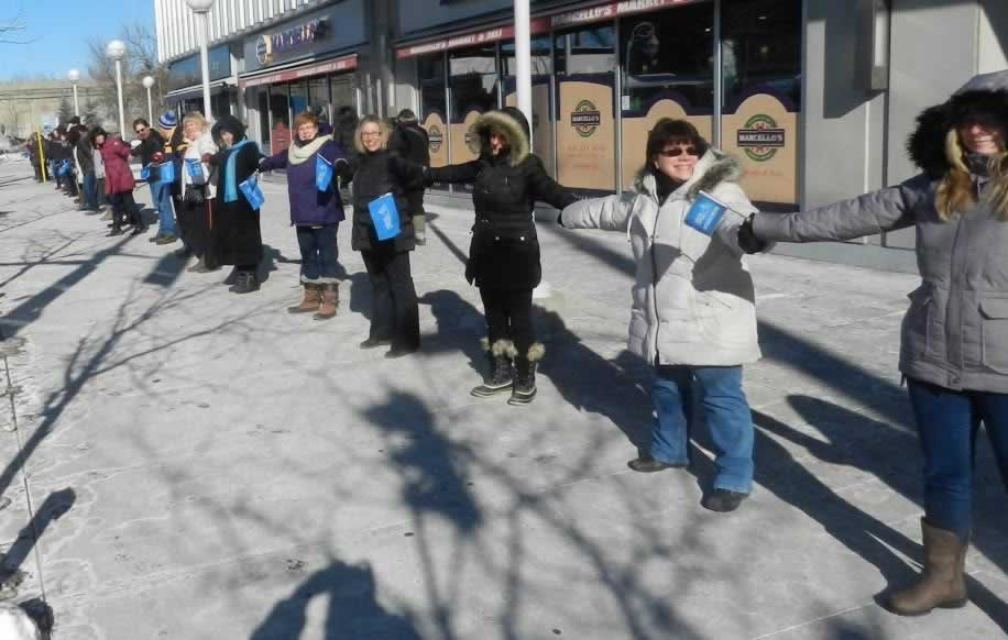 OPSEU members in a line, holding hands together in Ottawa