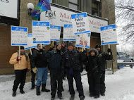 OPSEU members hold up signs as they attend protest outside of mpp meilleur's office