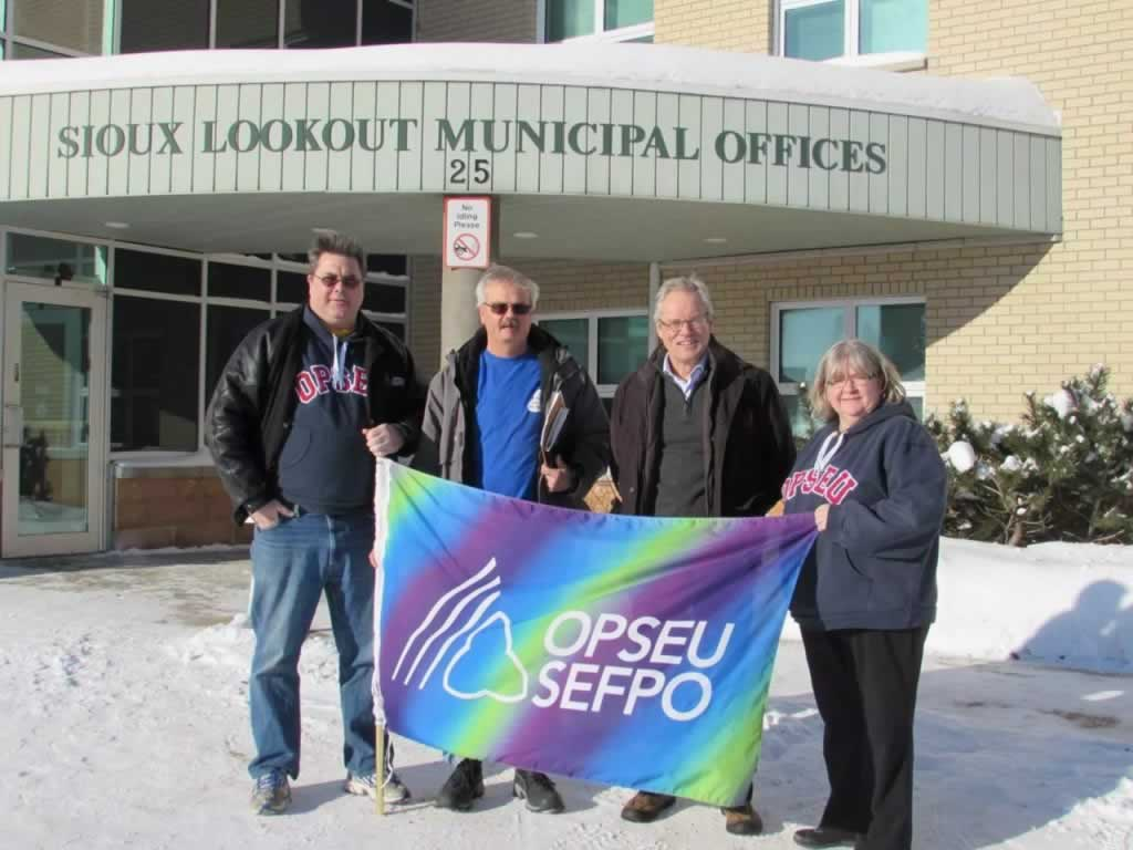 OPSEU members holding up OPSEU flag outside of Sioux lookout municipal offices