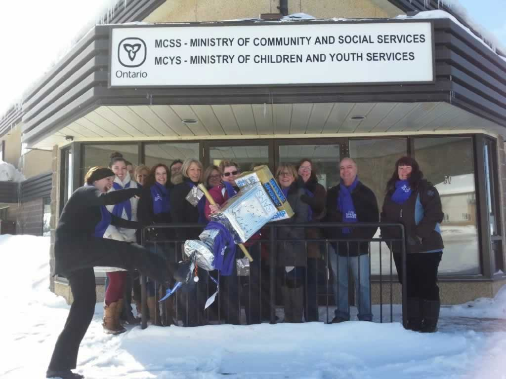 OPSEU members attend event in bracebridge. Standing in front of Ministry of Community & Social Services, Ministry of Children & Youth Services