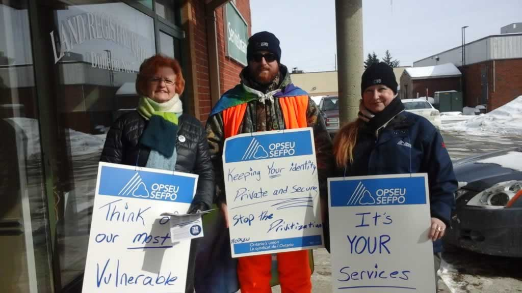 """OPSEU members attend rally in orangeville. They are holding signs that says """"it's your services"""""""