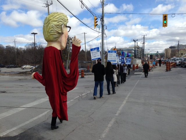 OPSEU members attending rally with Kathleen Wynne puppet