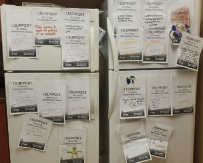 Windsor office's fridge. Covered in pieces of paper that say: I Support