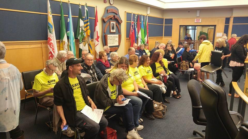OPSEU members wearing yellow Save Grey Gables t-shirts pack council meeting.