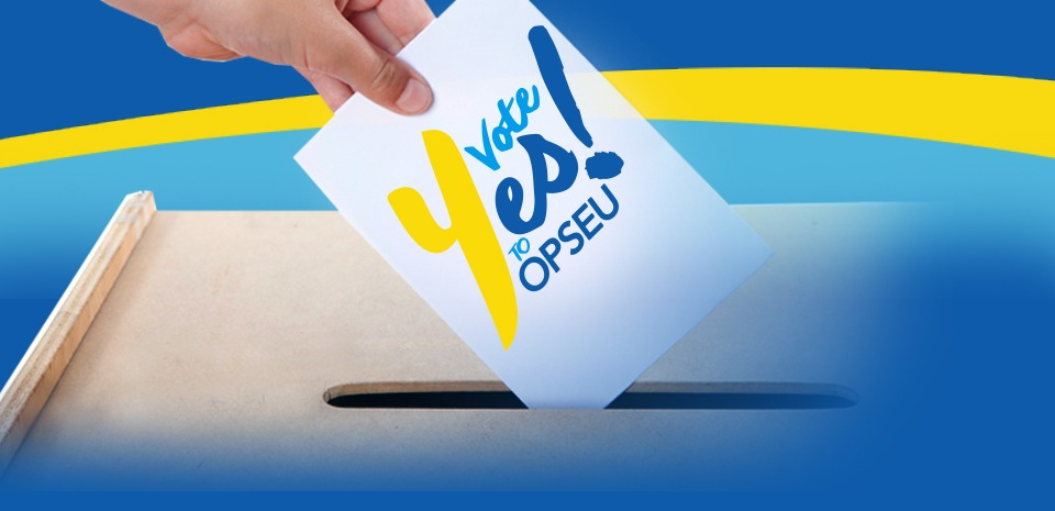 """Person putting a ballot that says """"Vote Yes to OPSEU!"""" into a ballot box."""
