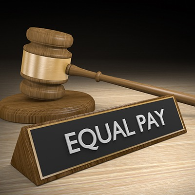 """Gavel behind deskplate that says """"Equal Pay"""""""