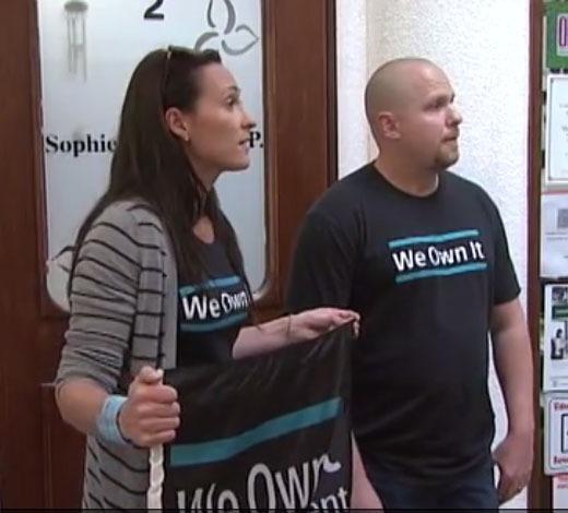 OPSEU members wearing We Own It shirts at anti-privatization rally.