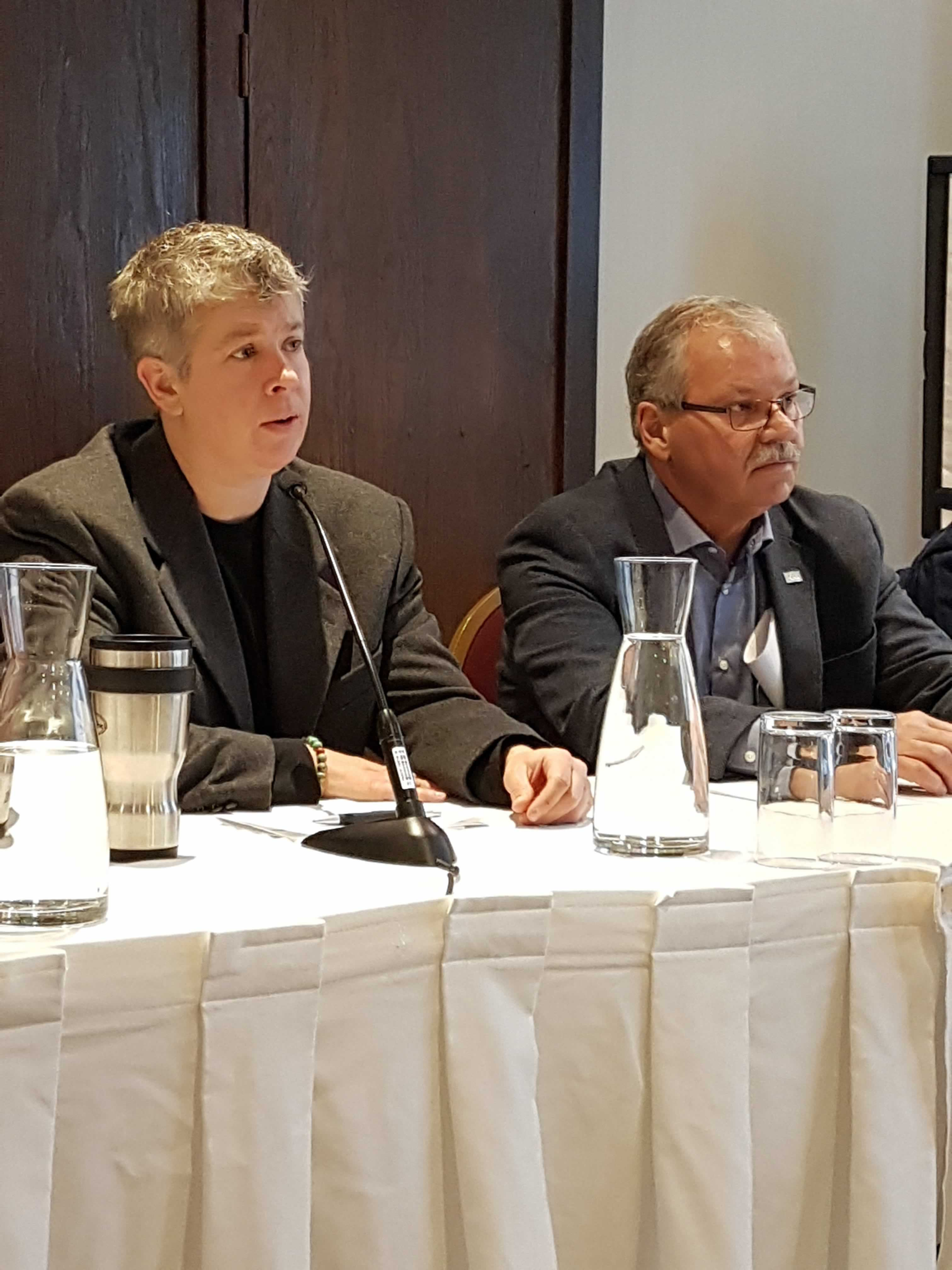 OPSEU college faculty bargaining team member JP Hornick and OPSEU President Warren (Smokey) Thomas speak at a news conference.
