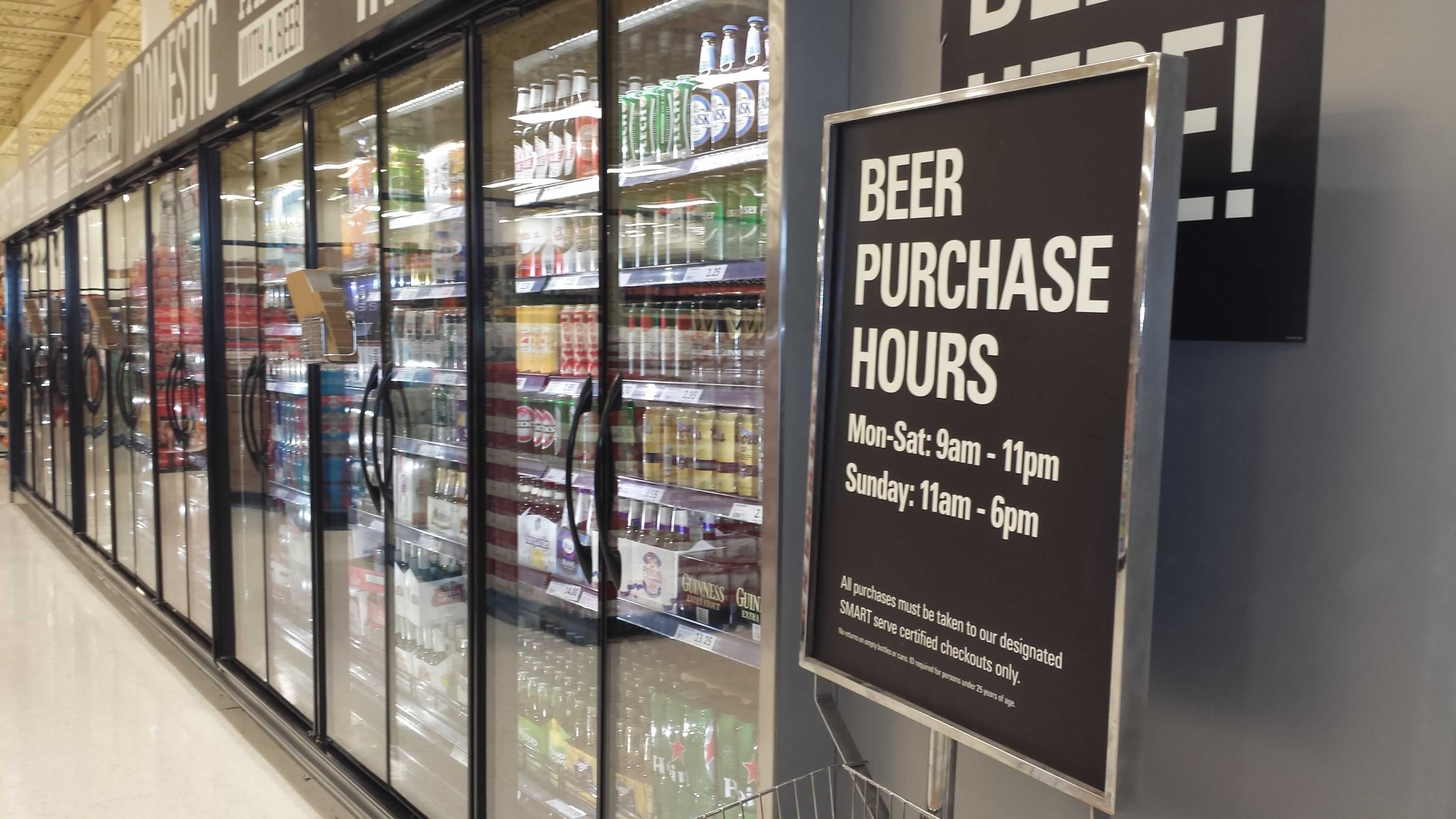 """Sign in grocery stores that says """"Beer Purchase Hours"""""""