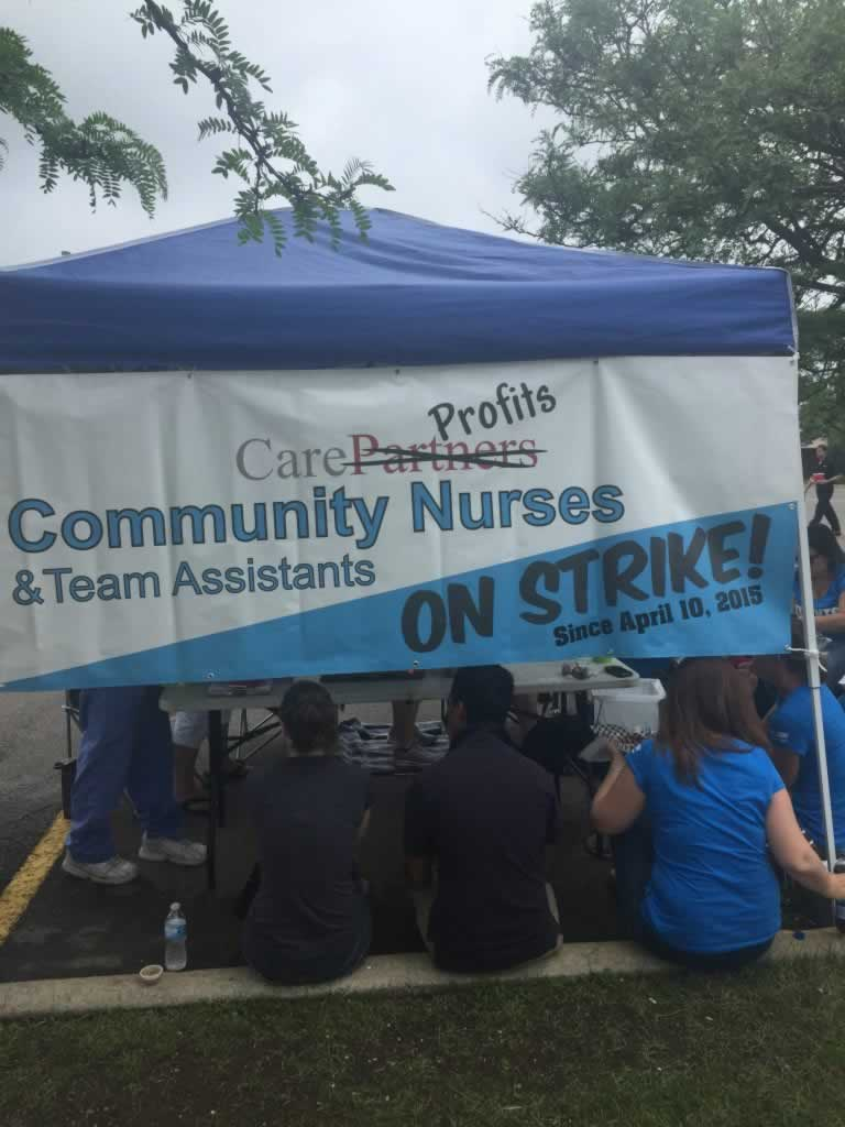 OPSEU members meet under tent during Care Partners strike.