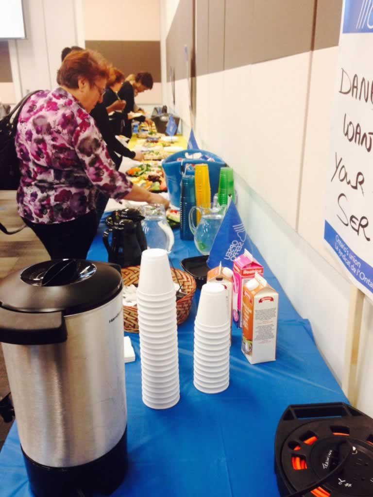 OPSEU members getting lunch from a table.