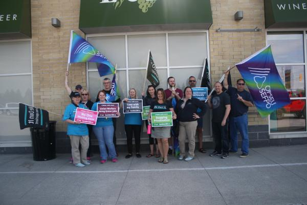 LBED workers standing in front of LCBO store in Napanee for information picket