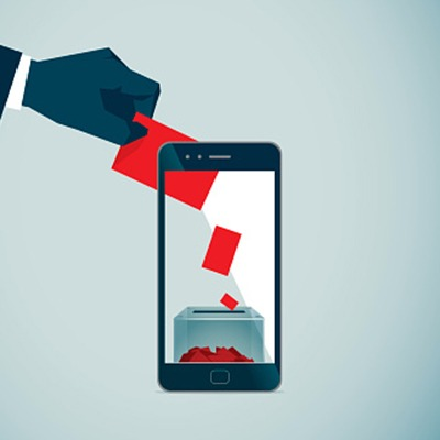 Electronic voting illustration showing hand putting ballot into smart phone.