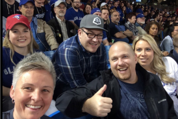 Large group of OPSEU members in the stands at a Blue Jays game.