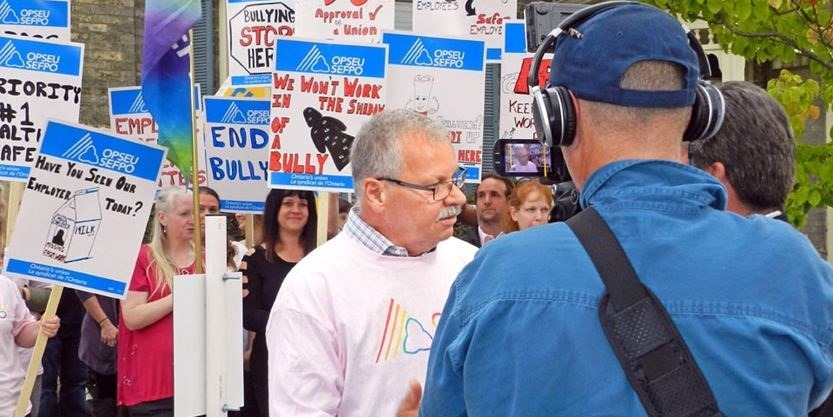 OPSEU President Warren (Smokey) Thomas speaks to reporters during a CMHA rally in Elgin.