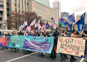 OPSEU flags at a rally for $15 & Fairness
