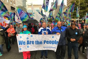 OPSEU members, including OPSEU First Vice-President/Treasurer Eduardo (Eddy) Almeida at Ontario Health Coalition rally.