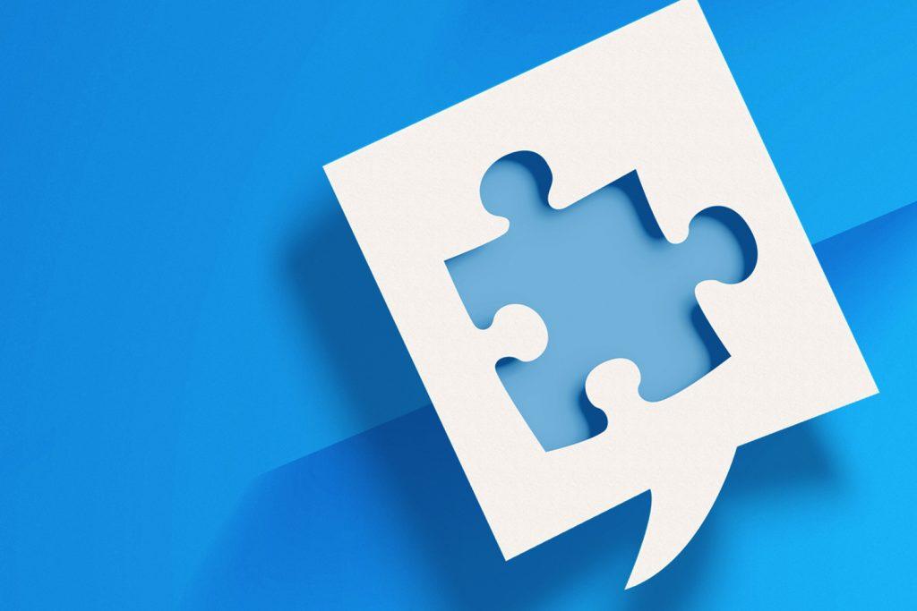 Puzzle piece speech bubble denoting cooperation concept