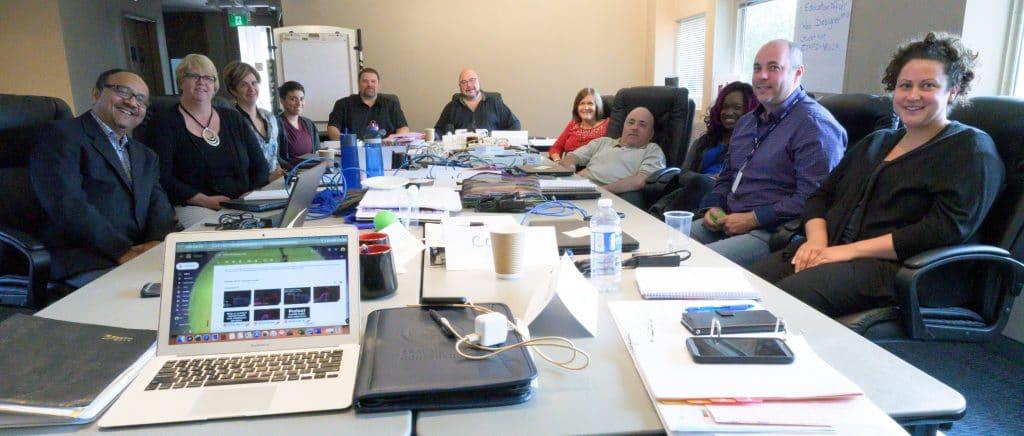 2019 MDT Trainees sitting around boardroom table