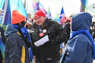 Eddy Almeida at OFL rally speaking with members