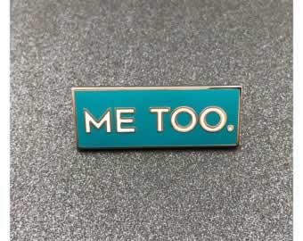 Me Too. Sign on table