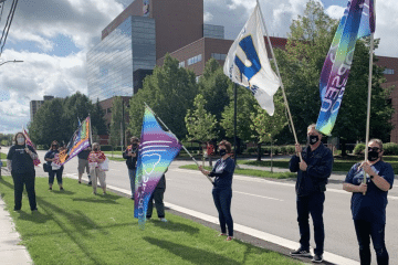 OPSEU members standing outside of MPP Ross Romano's office